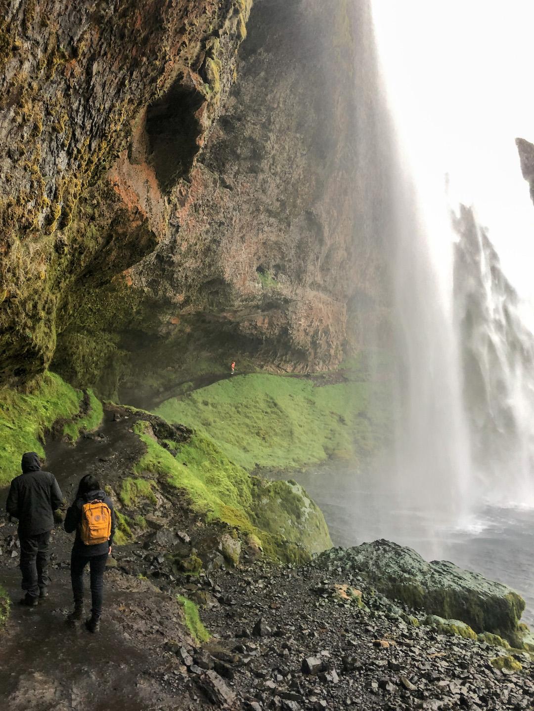 Walking to the inside of Seljalandsfoss