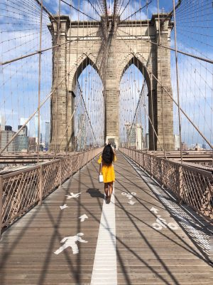 Her Travel Edit on the Brooklyn Bridge in New York City
